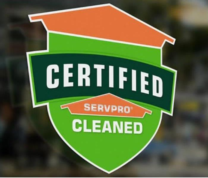 Certified: SERVPRO cleaned graphic on the window of a business